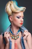 Girl with fancy hairstyle and makeup Stock Photo