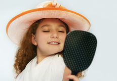 Girl in fancy hat Royalty Free Stock Image