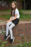 Girl with fancy  pair of tights. Teenage girl with fancy  pair of tights with little black hearts Stock Photography