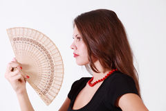 girl fanning herself Stock Photography