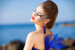 Girl in fantasy blue dress Royalty Free Stock Photos