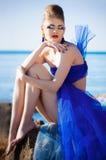 Girl in fantasy blue dress Stock Image