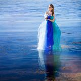 Girl in fantasy blue dress Stock Photos