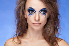 Girl with fantasy blue make up Royalty Free Stock Photos