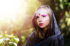 Girl with fantasy make up in woods. Stock Image
