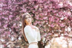 Girl in Fantasy Mystical and Magical Spring Garden. Fashion Model. Beauty Portrait. Beautiful royalty free stock photo