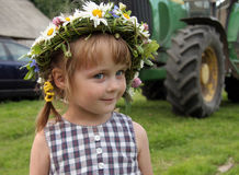 Girl in farm. Young cute girl with flowers in farm Royalty Free Stock Images