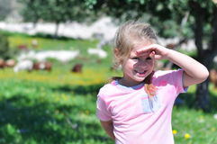 Girl on farm. Girl blinded by the sun on the farm Royalty Free Stock Image