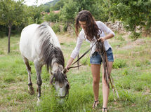 Girl with farm horse Stock Photography