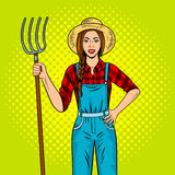 Girl farmer with pitchfork pop art vector. Girl farmer with pitchfork pop art retro vector illustration. Comic book style imitation Royalty Free Stock Photos