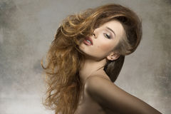 Girl with fashion bushy hair-style Royalty Free Stock Image