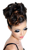Girl with fashion hairstyle. And creative eye make-up royalty free stock photos