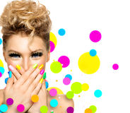 Girl with fashion hairstyle and colorful nail polish Royalty Free Stock Images