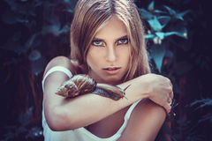 Girl with fashion makeup and snails Royalty Free Stock Image