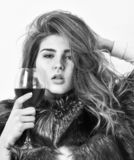 Girl fashion makeup wear fur coat hold glass alcohol. Elite leisure. Reasons drink red wine in wintertime. Lady fashion royalty free stock image
