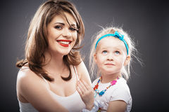Girl fashion portrait with young mother. Stock Photo