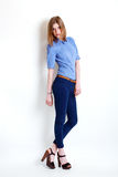 Girl in fashion stylish jeans Stock Photography