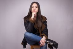 Girl fashion stylish posing isolated. Girl cute teenager brunette fashion stylish posing isolated on white stock photo