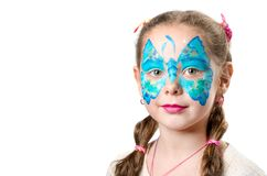 Girl with fashionable butterfly face art. Girl with fashionable face art makeup isolated on white background. Butterfly face art children royalty free stock photo