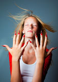 Girl with fashionable design of nails Stock Image