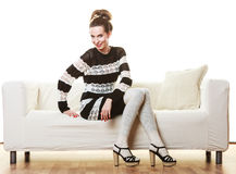 Girl fashionable dress high heels posing on couch. Royalty Free Stock Images