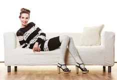 Girl fashionable dress high heels posing on couch. Stock Photos