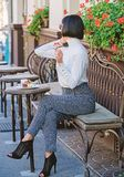 Girl fashionable lady with smartphone. Pleasant time and leisure. Relax and coffee break. Happy to hear you. Woman royalty free stock photo