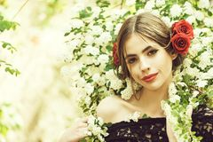 Girl with fashionable spanish makeup, rose flower in hair. Girl with fashionable makeup and red lips, has rose flower in hair hispanic or spanish style in black royalty free stock images