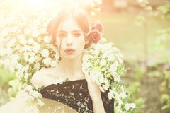 Girl with fashionable spanish makeup, rose flower in hair. Girl with fashionable makeup and red lips, has rose flower in hair hispanic or spanish style in black stock photography