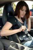 Girl fastening seat belt  Royalty Free Stock Photo