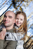 Girl and father in autumn forest Royalty Free Stock Image