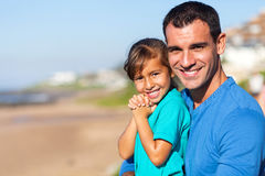 Girl father beach Stock Images