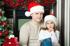 Girl and father in hats write letter to Santa Stock Photo