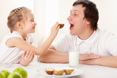 Girl with father have a breakfast Royalty Free Stock Photo