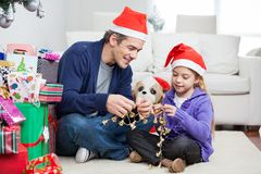 Girl And Father Holding Christmas Ornaments Stock Images