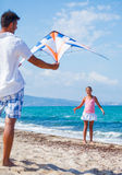 Girl and father with kite Royalty Free Stock Photo
