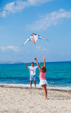 Girl and father with kite Stock Photography