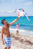 Girl and father with kite Royalty Free Stock Image