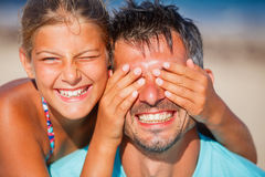 Girl  with father playing at the beach Royalty Free Stock Image