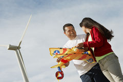 Girl With Father At Wind Farm Stock Images