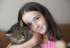 Girl with a favourite cat Royalty Free Stock Photo