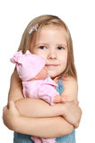 The girl with a favourite doll Royalty Free Stock Photos