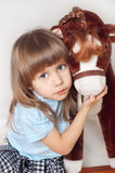The girl with a favourite toy Stock Photography