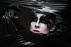 Girl with feather eyelashes Stock Photography