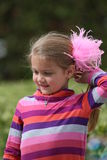 Girl with feathers in her hair Stock Images