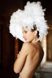 Girl with feathers on her head Royalty Free Stock Photography
