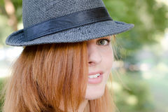 Girl with fedora hat Stock Images