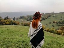 Girl with fedora. Girl on hill with fedora hat autumn stock photo