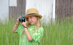 Girl with fedora and old camera Royalty Free Stock Images