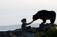 Girl feeding bear Stock Photos
